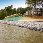 Slope stabilization with riprap and hydroseeding, private residence