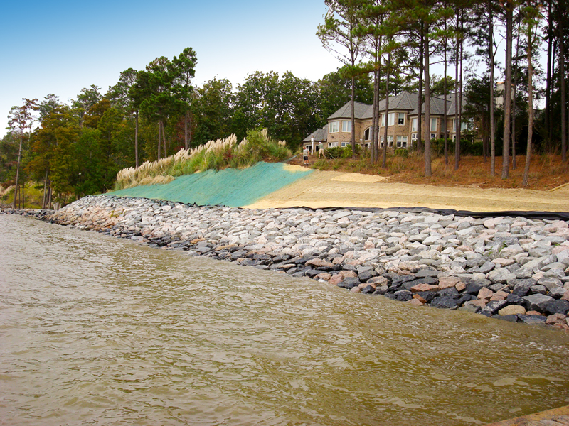 Slope stabilization with riprap and hydroseeding, private residence, James City County, Virginia
