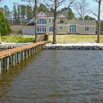 Completed beach creation/beach nourishment project with riprap erosion control. Private residence, Chickahominy River, Virginia.