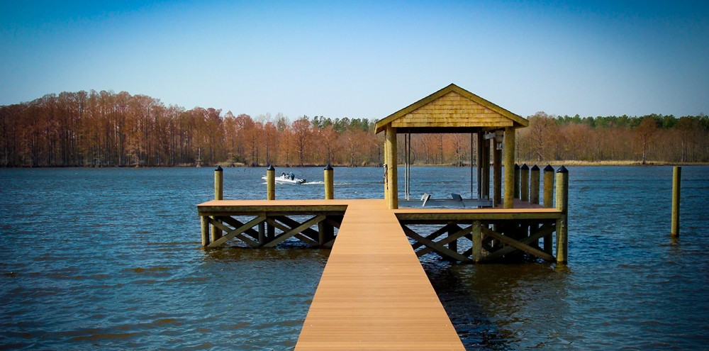 Boathouse on the Chickahominy River with 200' pier with synthetic decking, boat lift and boat slip.